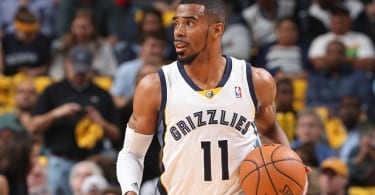 MEMPHIS, TN - MAY 3: Mike Conley #11 of the Memphis Grizzlies dribbles up the court against the Oklahoma City Thunder in Game Six of the Western Conference Quarterfinals during the 2014 NBA Playoffs on MAY 3, 2014 at FedExForum in Memphis, Tennessee. NOTE TO USER: User expressly acknowledges and agrees that, by downloading and or using this photograph, User is consenting to the terms and conditions of the Getty Images License Agreement. Mandatory Copyright Notice: Copyright 2014 NBAE (Photo by Joe Murphy/NBAE via Getty Images)