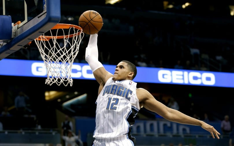 Orlando Magic's Tobias Harris makes an uncontested dunk during the final seconds of overtime in an NBA basketball game against the Milwaukee Bucks, Wednesday, April 10, 2013, in Orlando, Fla. Orlando won 113-103. (AP Photo/John Raoux) ORG XMIT: DOA108