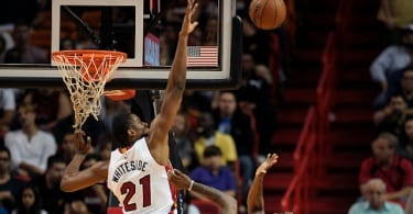 The Miami Heat's Hassan Whiteside (21) blocks the shot of the Orlando Magic's Ben Gordon during the first half at the AmericanAirlines Arena in Miami on Monday, Dec. 29, 2014. (Michael Laughlin/Sun Sentinel/TNS via Getty Images)