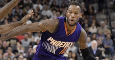 Phoenix Suns guard Sonny Weems (10) drives around San Antonio Spurs forwards Jonathon Simmons and LaMarcus Aldridge, left, during the first half of a preseason NBA basketball game, Tuesday, Oct. 20, 2015, in San Antonio. (AP Photo/Darren Abate)