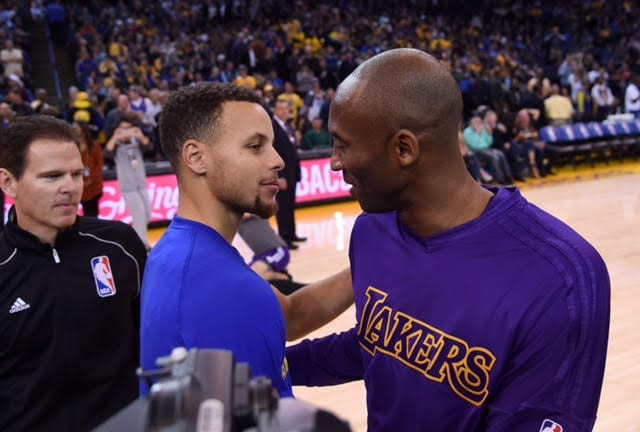 OAKLAND, CA - NOVEMBER 24:  Stephen Curry #30 of the Golden State Warriors meets at center court with Kobe Bryant #24 of the Los Angeles Laker prior to the start of their NBA basketball game at ORACLE Arena on November 24, 2015 in Oakland, California. NOTE TO USER: User expressly acknowledges and agrees that, by downloading and or using this photograph, User is consenting to the terms and conditions of the Getty Images License Agreement.  (Photo by Thearon W. Henderson/Getty Images)