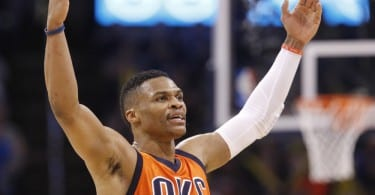 Oklahoma City Thunder guard Russell Westbrook gestures to the crowd in the third quarter of an NBA basketball game against the Miami Heat in Oklahoma City, Sunday, Jan. 17, 2016. Oklahoma City won 99-74. (AP Photo/Sue Ogrocki) ORG XMIT: OKSO