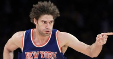 New York Knicks center Robin Lopez (8) points to a teammate during the second half of an NBA basketball game against the Los Angeles Lakers in Los Angeles, Sunday, March 13, 2016. The Knicks won 90-87. (AP Photo/Alex Gallardo)