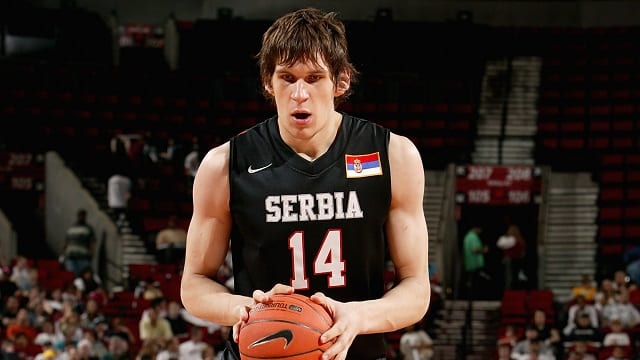 PORTLAND, OR - APRIL 12:  Boban Marjanovic #14 of Team World shoots a free throw in the game against Team USA during the Nike Hoop Summit on April 12, 2008 at the Rose Garden in Portland, Oregon.  Team USA won 98-78.  NOTE TO USER:  User expressly acknowledges and agrees that, by downloading and or using this photograph, User is consenting to the terms and conditions of the Getty Images License Agreement. Mandatory Copyright Notice: Copyright 2008 NBAE  (Photo by Sam Forencich/NBAE via Getty Images)