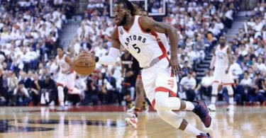 TORONTO, ON - MAY 11:  DeMarre Carroll #5 of the Toronto Raptors dribbles the ball in the first half of Game Five of the Eastern Conference Semifinals against the Miami Heat during the 2016 NBA Playoffs at the Air Canada Centre on May 11, 2016 in Toronto, Ontario, Canada.  NOTE TO USER: User expressly acknowledges and agrees that, by downloading and or using this photograph, User is consenting to the terms and conditions of the Getty Images License Agreement.  (Photo by Vaughn Ridley/Getty Images)