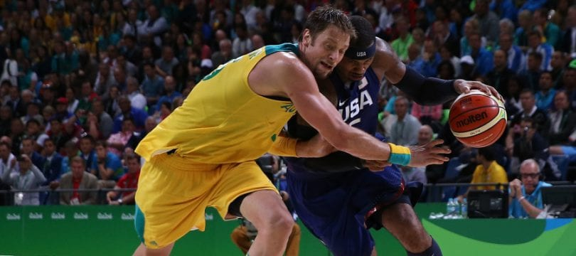 RIO DE JANEIRO, BRAZIL - AUGUST 10:  Carmelo Anthony #15 of United States drives the ball against David Andersen #13 of Australia during a Preliminary Round Basketball game between Australia and the United States on Day 5 of the Rio 2016 Olympic Games at Carioca Arena 1 on August 10, 2016 in Rio de Janeiro, Brazil.  (Photo by Elsa/Getty Images)