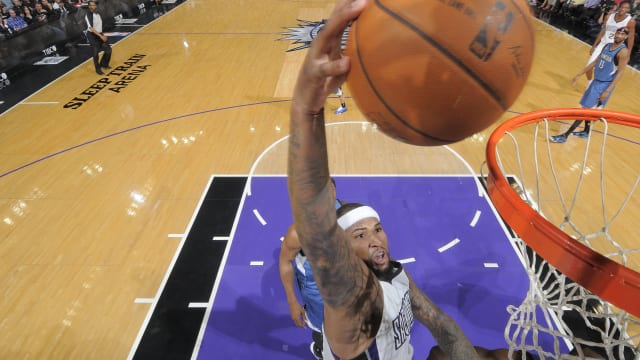 SACRAMENTO, CA - APRIL 13: DeMarcus Cousins #15 of the Sacramento Kings dunks against the Minnesota Timberwolves  at Sleep Train Arena on April 13, 2014 in Sacramento, California. NOTE TO USER: User expressly acknowledges and agrees that, by downloading and or using this photograph, User is consenting to the terms and conditions of the Getty Images Agreement. Mandatory Copyright Notice: Copyright 2014 NBAE (Photo by Rocky Widner/NBAE via Getty Images)