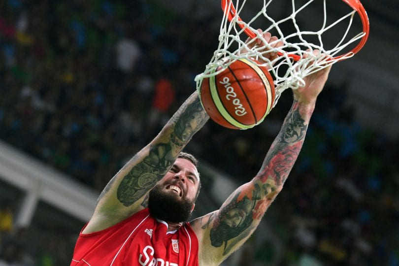 TOPSHOT - Serbia's centre Miroslav Raduljica scores during a Men's round Group A basketball match between Venezuela and Serbia at the Carioca Arena 1 in Rio de Janeiro on August 6, 2016 during the Rio 2016 Olympic Games. / AFP PHOTO / Andrej ISAKOVICANDREJ ISAKOVIC/AFP/Getty Images ** OUTS - ELSENT, FPG, CM - OUTS * NM, PH, VA if sourced by CT, LA or MoD **
