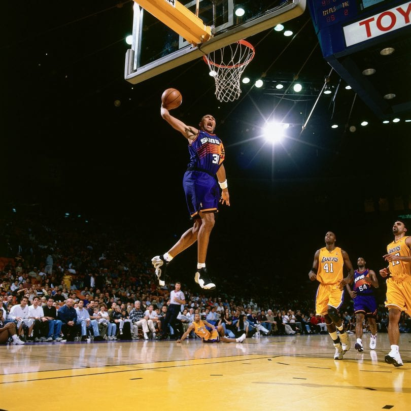 LOS ANGELES - 2000:  Shawn Marion #31 of the Phoenix Suns goes for a dunk against the Los Angeles Lakers during the NBA game at the Staples Center circa 2000 in Los Angeles, California.  NOTE TO USER: User expressly acknowledges and agrees that, by downloading and/or using this Photograph, User is consenting to the terms and conditions of the Getty Images License Agreement. Mandatory Copyright Notice: Copyright 2000 NBAE (Photo by NBA Photo Library/NBAE via Getty Images)