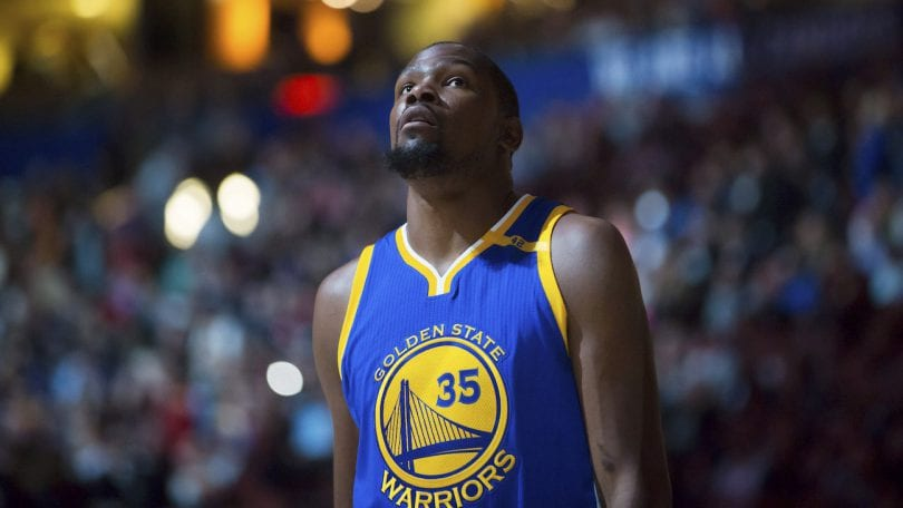 Golden State Warriors' Kevin Durant looks on before a preseason NBA basketball game against the Toronto Raptors, in Vancouver, British Columbia, Saturday Oct. 1, 2016. (Darryl Dyck/The Canadian Press via AP)