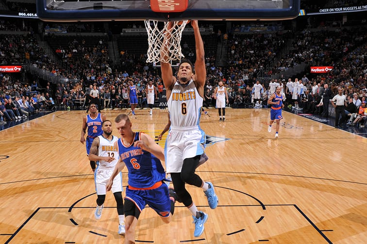 DENVER, CO - MARCH 8:  Axel Toupane #6 of the Denver Nuggets goes to the basket against the New York Knicks on March 8, 2016 at the Pepsi Center in Denver, Colorado. NOTE TO USER: User expressly acknowledges and agrees that, by downloading and/or using this Photograph, user is consenting to the terms and conditions of the Getty Images License Agreement. Mandatory Copyright Notice: Copyright 2016 NBAE (Photo by Garrett Ellwood/NBAE via Getty Images)