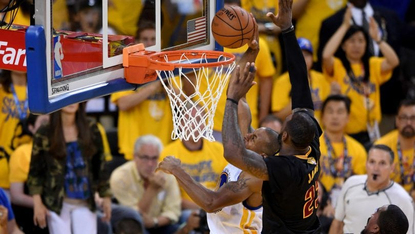 OAKLAND, CA - JUNE 19: LeBron James #23 of the Cleveland Cavaliers blocks a shot by Andre Iguodala #9 of the Golden State Warriors in Game 7 of the 2016 NBA Finals at ORACLE Arena on June 19, 2016 in Oakland, California. NOTE TO USER: User expressly acknowledges and agrees that, by downloading and or using this photograph, User is consenting to the terms and conditions of the Getty Images License Agreement.   Thearon W. Henderson/Getty Images/AFP